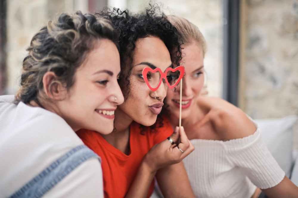 three women posing for photo